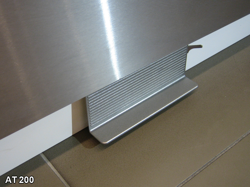 A sink faucet pedal valve is shown under kitchen cabinet doors